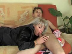 A mature hottie seduces her younger boyfriend at home