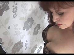 Attractive mature lady with big tits in stockings teases and strips