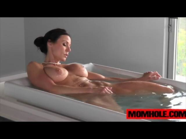 busty milf satisfying herself in the tub