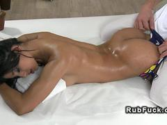 Busty Latina goddess sliding on a massage clients hard cock