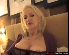 Mature German lady showing her juicy tits and gaping pussy.