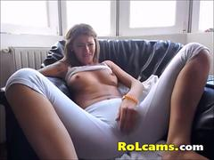 Teen in pants masturbates with her fingers