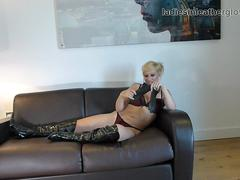Kinky blonde in boots bra and panties masturbates with naughty soft leather gloves