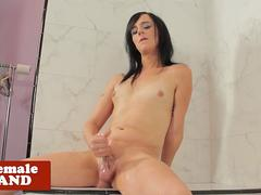 Solo trans wanks oiled cock in bathroom