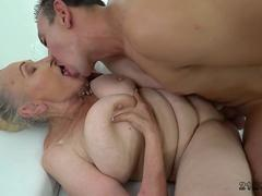 Busty granny fucked by a stud