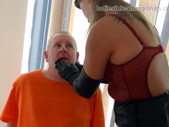 Smoking leather clad blonde Mistress in gloves and boots fetish domination session