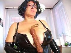 Busty Dominatrix Baraca in latex corset has a big whip