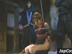 Tied up asian slave gets tortured by two ninjas