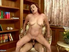 Horny mature redhead fucking with a younger man