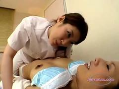 Asian Woman Massaged Getting Her Nipples Sucked By The Masseuse On The Massage Bed