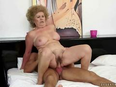 Old granny fucks an younger dude and loves every minute