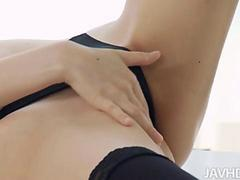 Decadent Yuria in black lingerie and black thigh high stockings toys her pussy