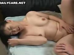 Brunette Asian chick shows her sexy and ripe big boobs