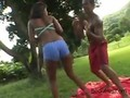 Horny black chick fucks her trainer in the park