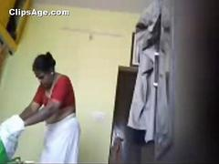 Indian desi Tamil maid changing dress in her room captured using hidden cam
