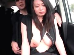 Asian girl gets her tits grabbed  in a car