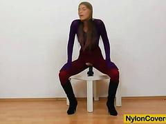 Brunette covered in pantyhose fingering pussy plus dildo