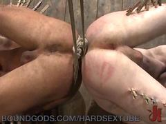 Muscled Dom Punishes Two Slaves
