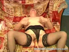 Dirty old granny gets her wet hairy pussy fingered