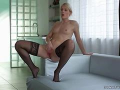 Beautiful blonde in black stockings masturbating