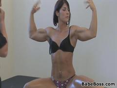 Sexy Fitness Model Getting Oiled Up