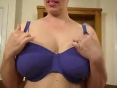 taking off her bra and posing them off