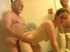 Swinging couples having a home orgy
