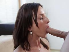 Brunette sucking a jumbo boner and enjoying every inch