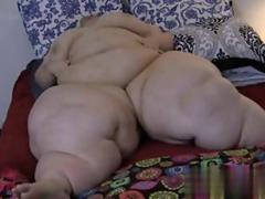 Humongous blonde bbw shows off her immobilized body in bed