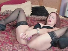Red Haired milf has fun with pink vibrator