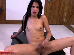 Black haired tranny dances around the pole before stroking