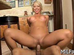 Short hair blonde MILF sliding on a fat young dick
