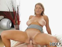 Big boobed blonde darling riding a fat cock in a reverse cowgirl position