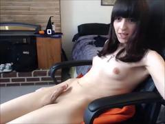 Young brunette tranny makes her small cock