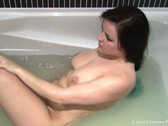 Lovely girl takes a bath and masturbates