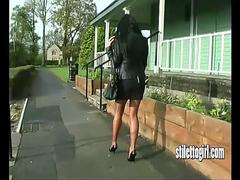 Hot leggy babe teases in short skirt her sexy nylons and high heel stilettos