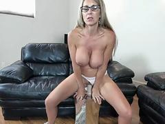 An big breasted blonde slut is riding on top of a huge dildo for a webcam show