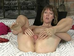 Hot mature slut teasing naked on a webcam and masturbate her wet cunt with a pink dildo