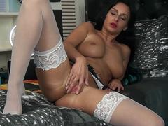 Splendid busty chick lying on a bed naked and masturbate teasing on a wbcam