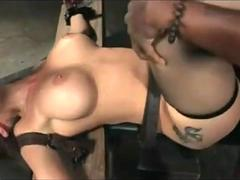 A hot busty mommy is being tied up to a bench and abused