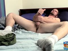 Naughty dude Nolan enjoys wanking his raging schlong