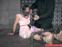 Submissive slut is being tied up and abused roughly in a dungeon