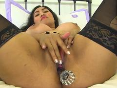 Big titted Asian lady dildoing her pussy