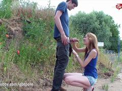 Teen fit babe goes for a quickie and facial behind a busy urban road