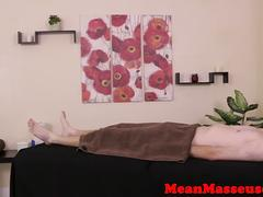 Mean masseuse ties up balls during handjob