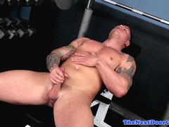 Tattooed hunk wanking in the gym