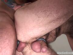 Tattooed hairy wolf anally fucked from behind