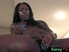 Chubby trans ebony pleasuring herself
