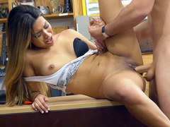 Busty babe Nicole sucking cock at a pawn shop