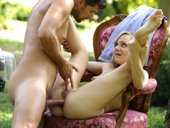Petite blonde Lucette Nice enjoys deep anal sex in the garden